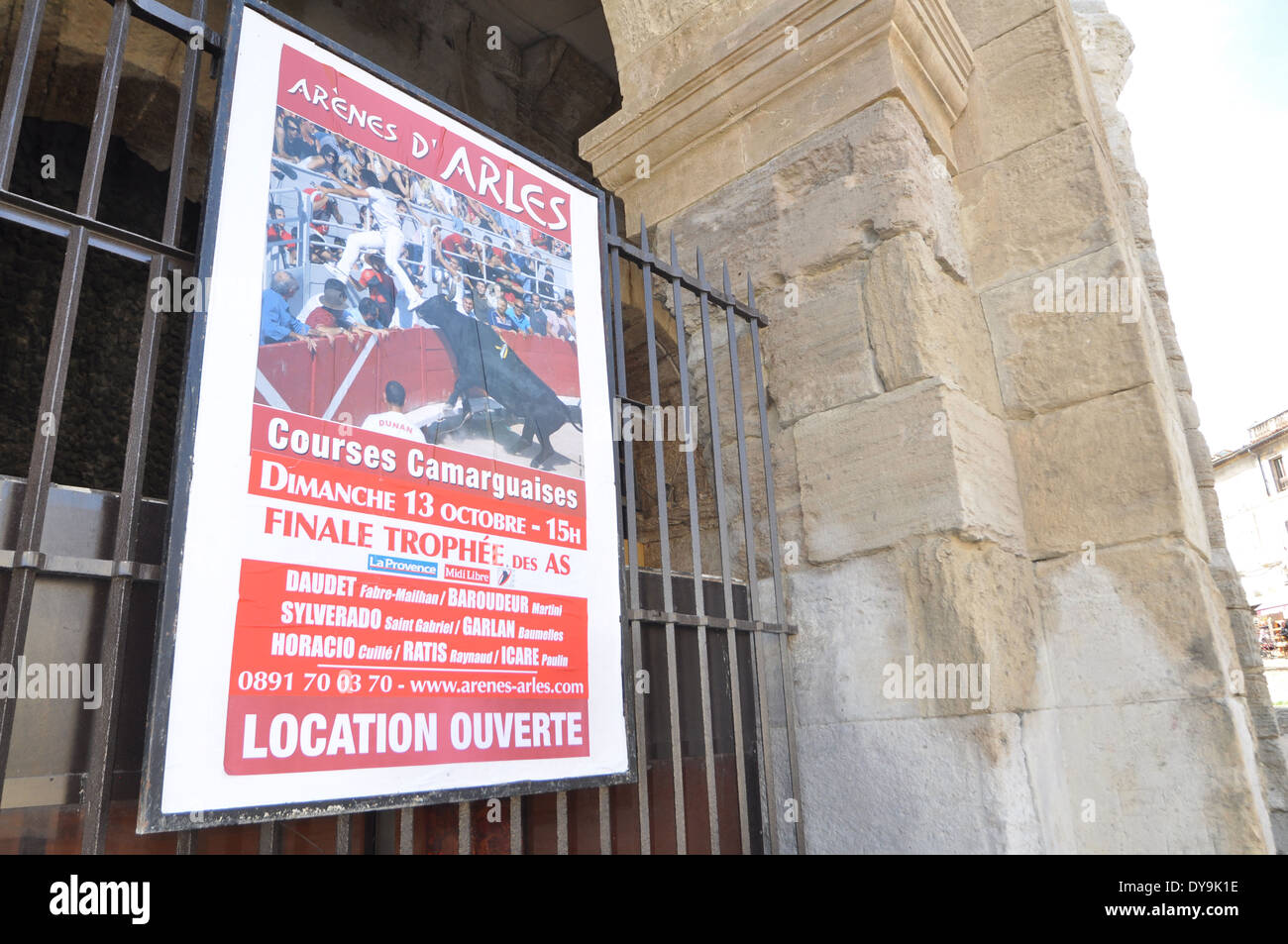 Poster advertising bullfight on the spruced-up stone-blasted arches of the Roman Amphitheatre  in Arles France - Stock Image
