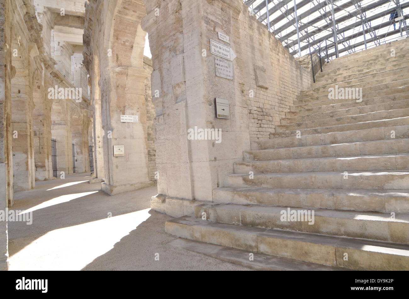 The spruced-up stone-blasted arches and steps of the Roman Amphitheatre in Arles France - Stock Image
