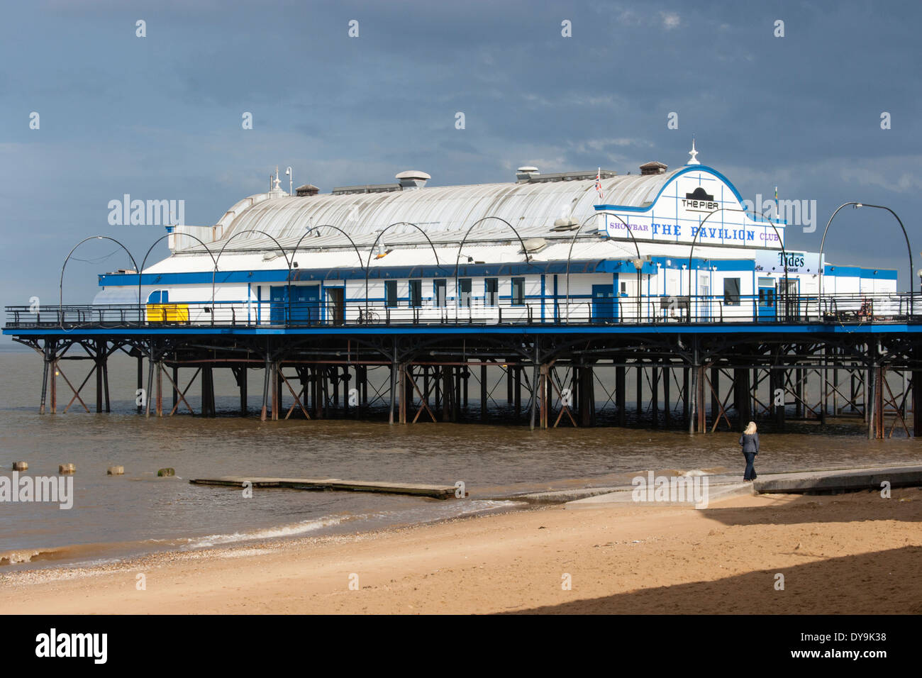 The pier at Cleethorpes, North East Lincolnshire, one walker on the beach - Stock Image