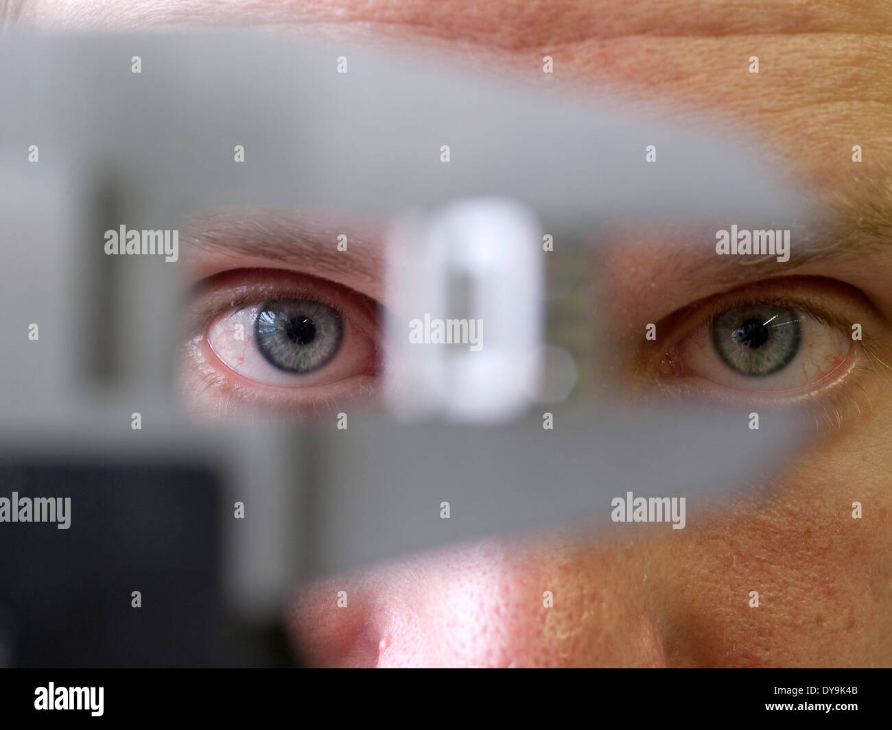 Eyes looking to caliper - Stock Image