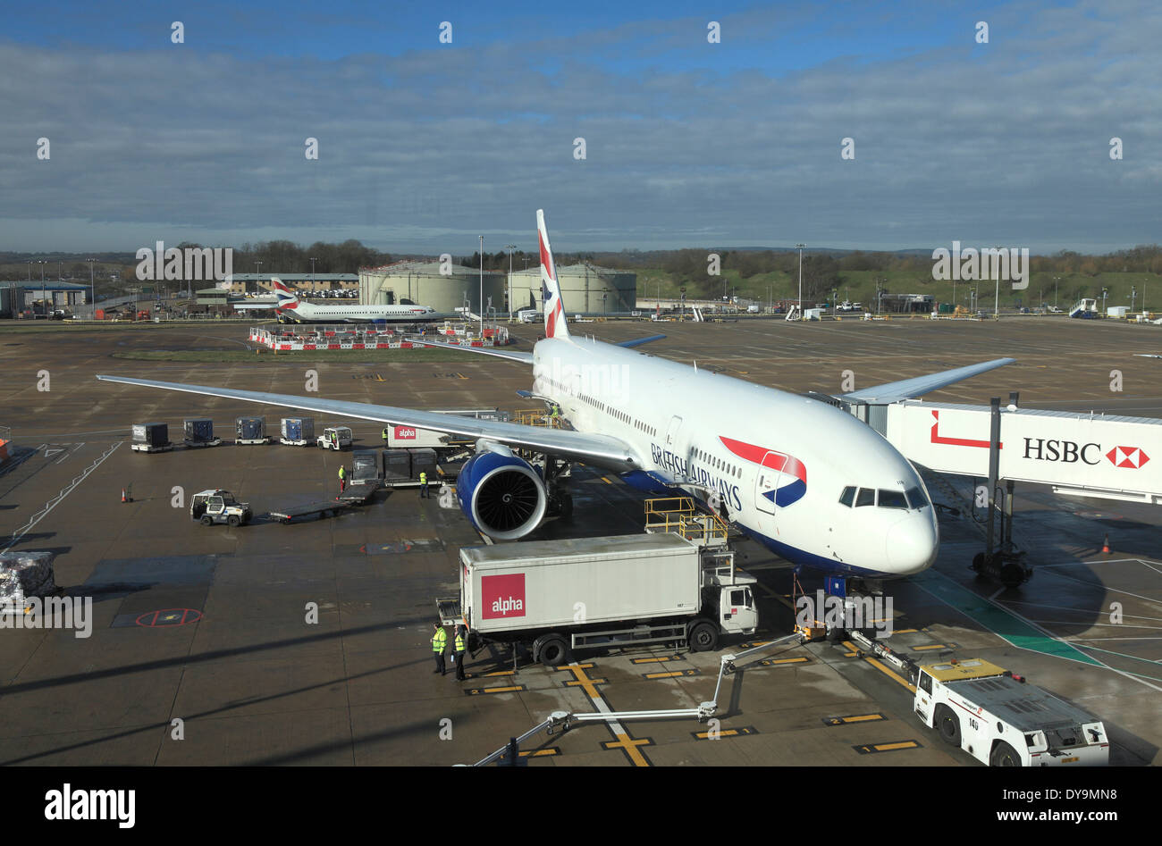 British Airways Boeing loading Cargo and supplies at Gatwick Airport - Stock Image