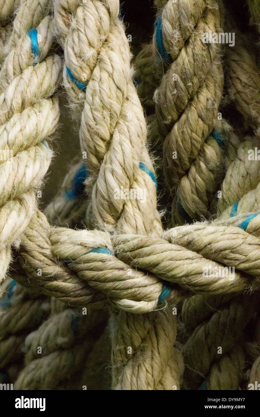 Weather rope with blue fleck twisted and looped. - Stock Image