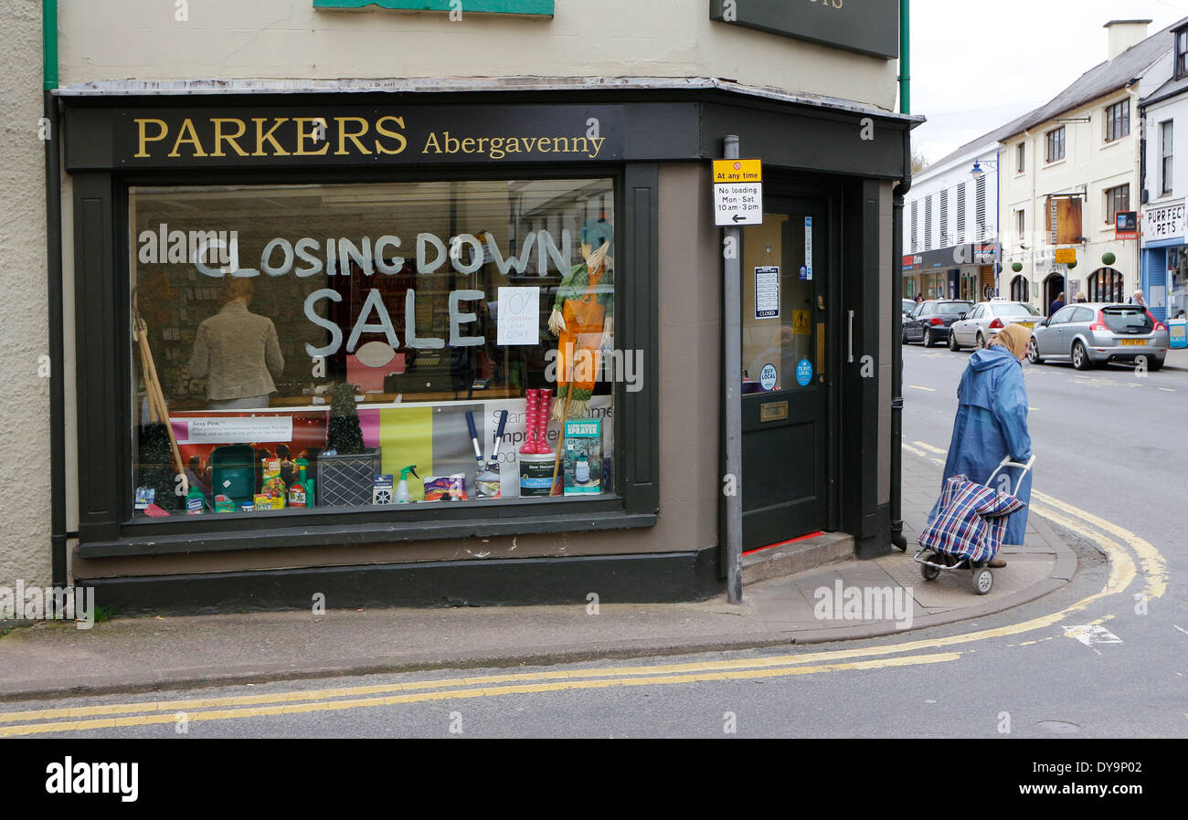 Shop window with closing down sale sign, Abergavenny, Wales, UK - Stock Image