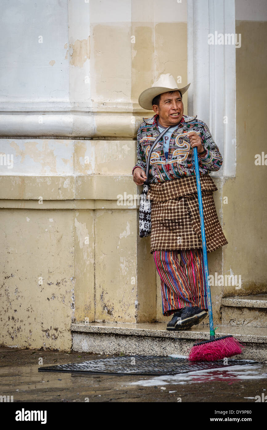 Kaqchikel Mayan man takes a breather from sweeping out the church - Sololá, Guatemala - Stock Image