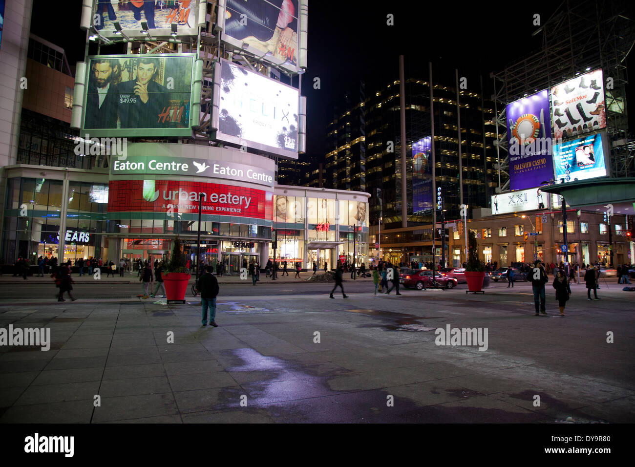 dundas square in toronto at night with billboards - Stock Image