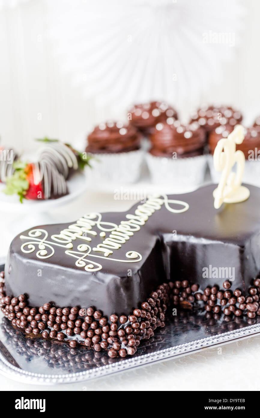 Celebrating wedding anniversary with heart shape chocolate cake ...