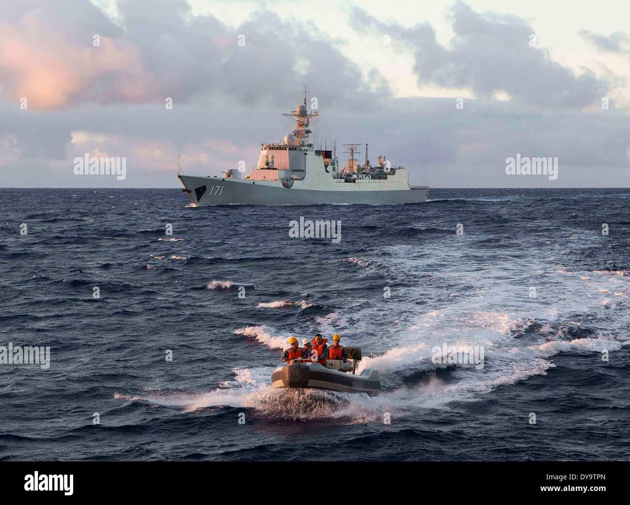 Canberra. 9th Apr, 2014. Picture released by Australian Defense Force (ADF) and taken on April 9, 2014 shows Chinese Navy soliders driving a boat to the Royal Australian Navy ship HMAS Success during the search for the missing Malaysia Airlines Flight MH370. Australian Prime Minister Tony Abbott said on April 11 that he is confident the signals captured over the past days were from the black box of the missing Malaysian flight. Credit:  ADF/Xinhua/Alamy Live News - Stock Image