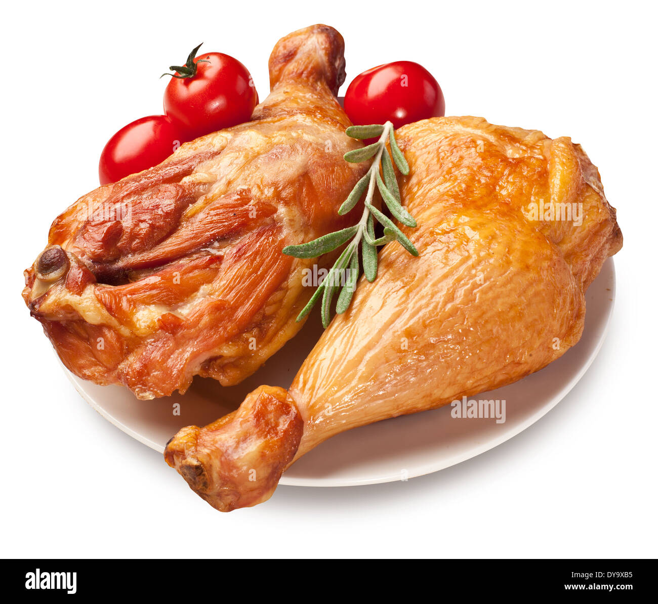 Smoked chicken with tomatoes on a white plate. Clipping paths. - Stock Image