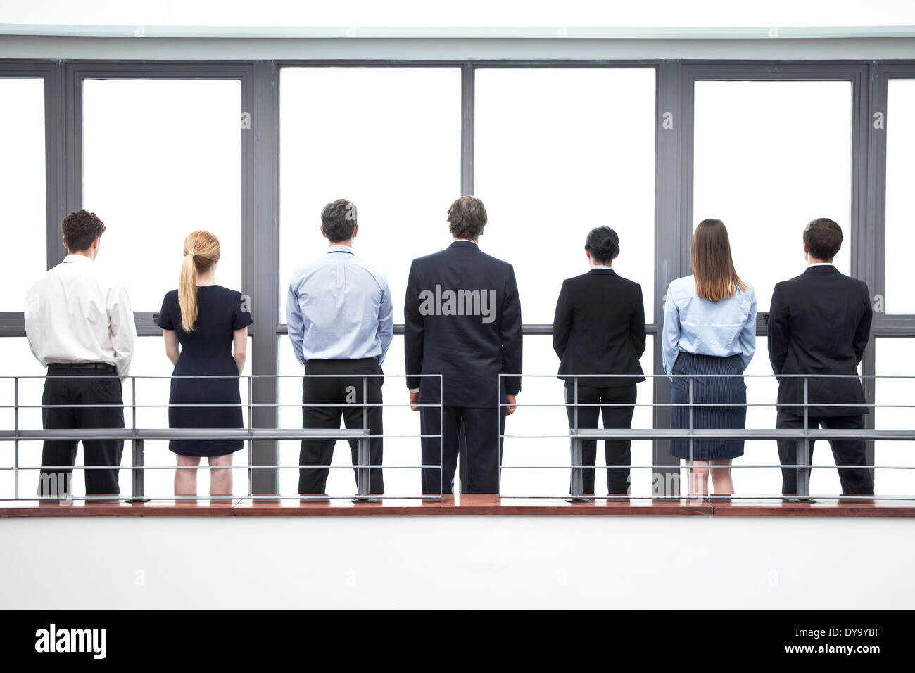 Team of business professionals, rear view - Stock Image