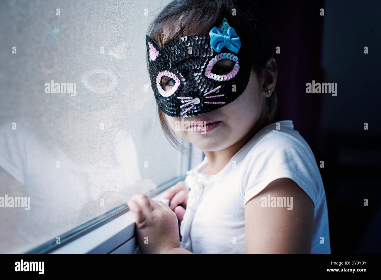 Little girl wearing mask - Stock Image