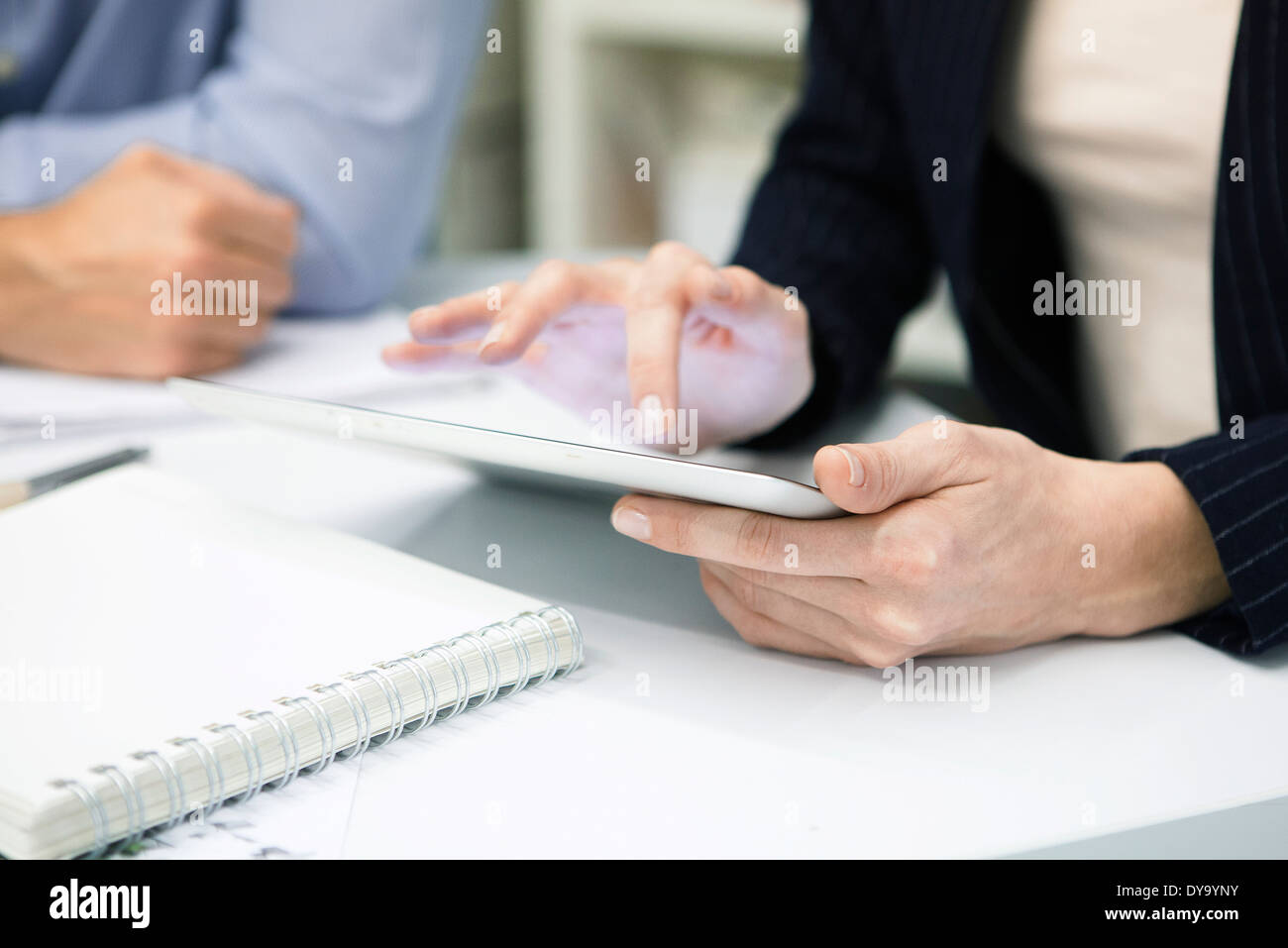 Businesswoman using digital tablet, cropped - Stock Image