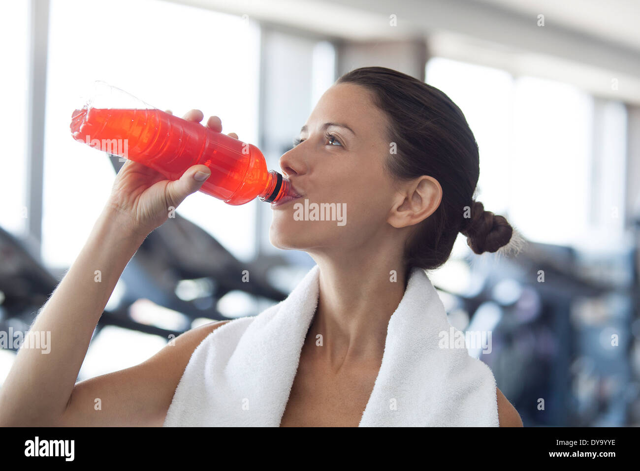 Woman hydrating after working out Stock Photo