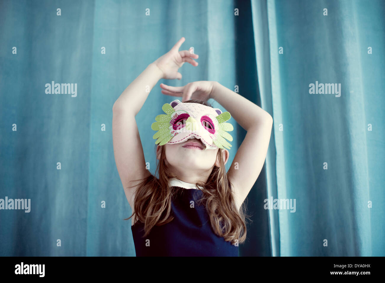 Llittle girl wearing mask - Stock Image