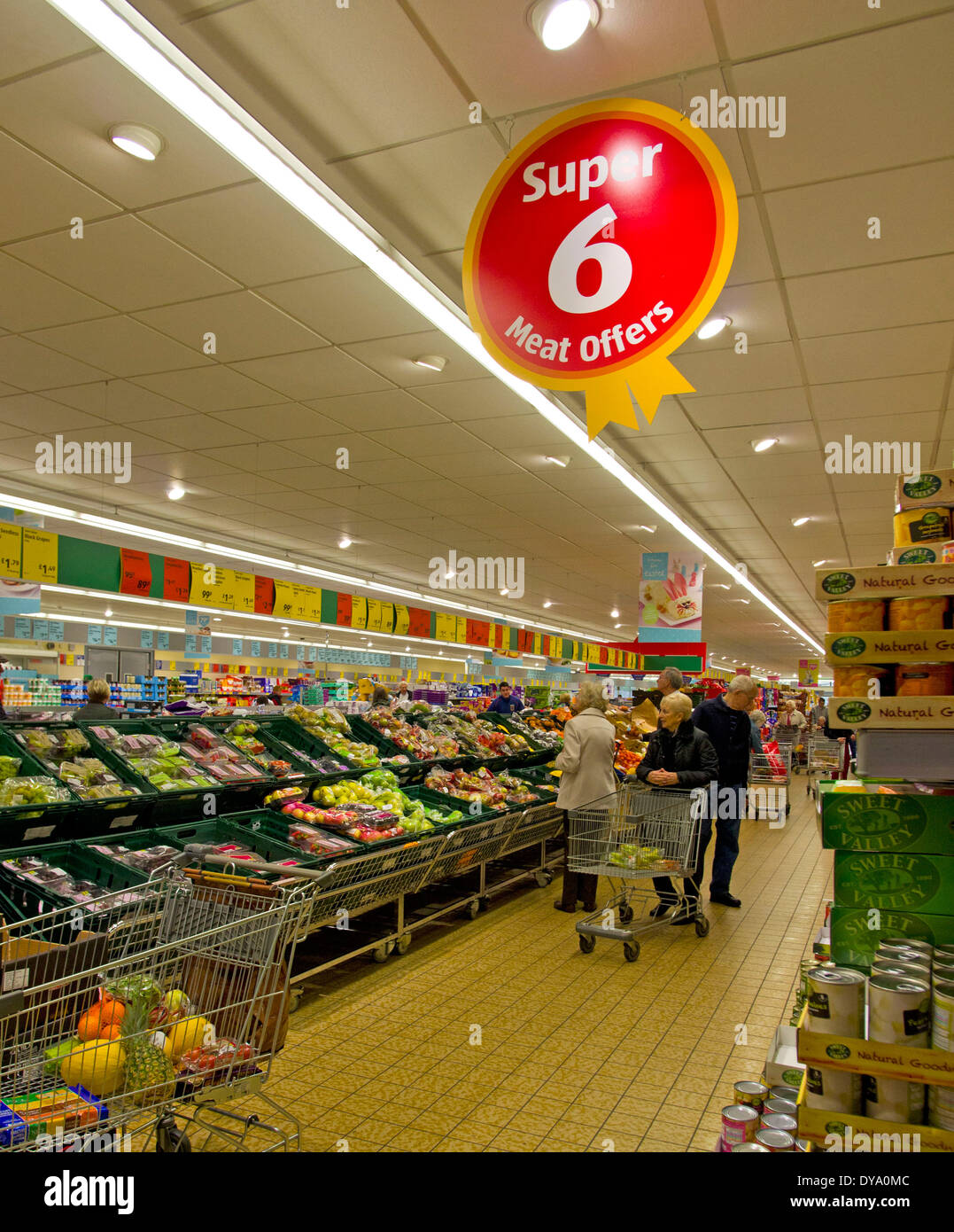 display of fresh vegetables and offers in Aldi discount supemarket - Stock Image