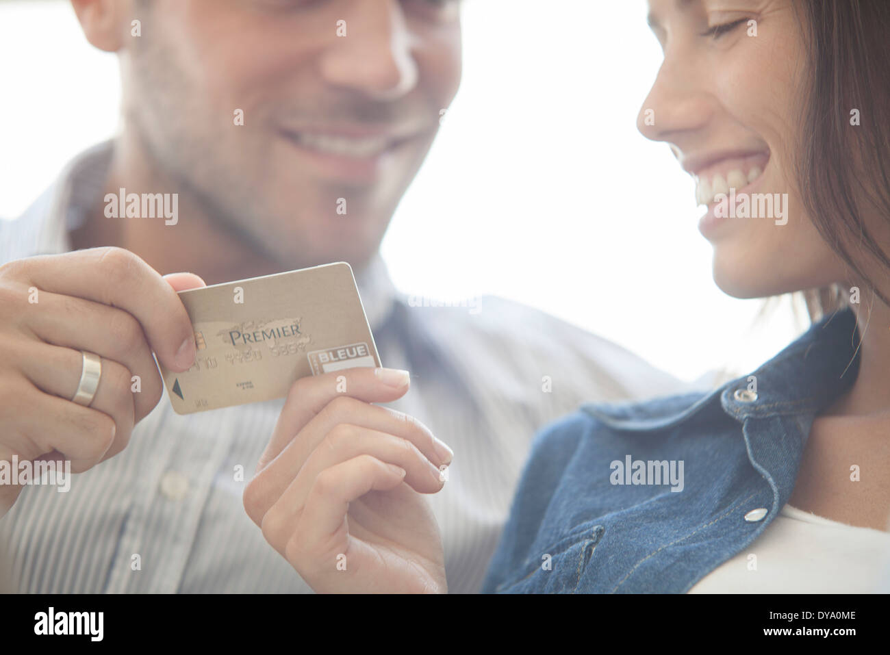 Couple preparing to make credit card purchase - Stock Image