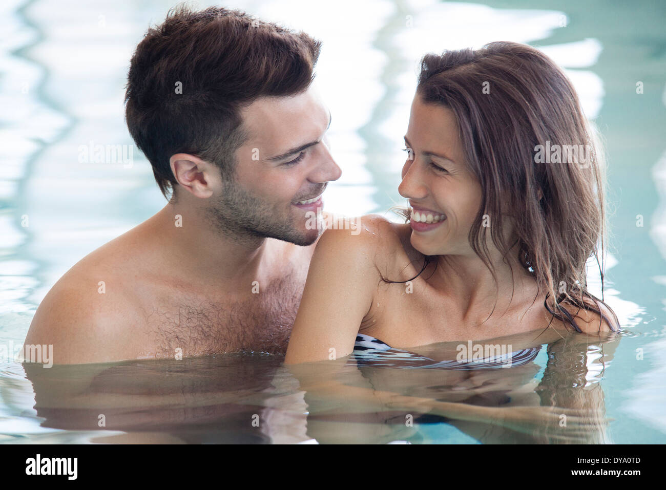 Couple in pool together - Stock Image