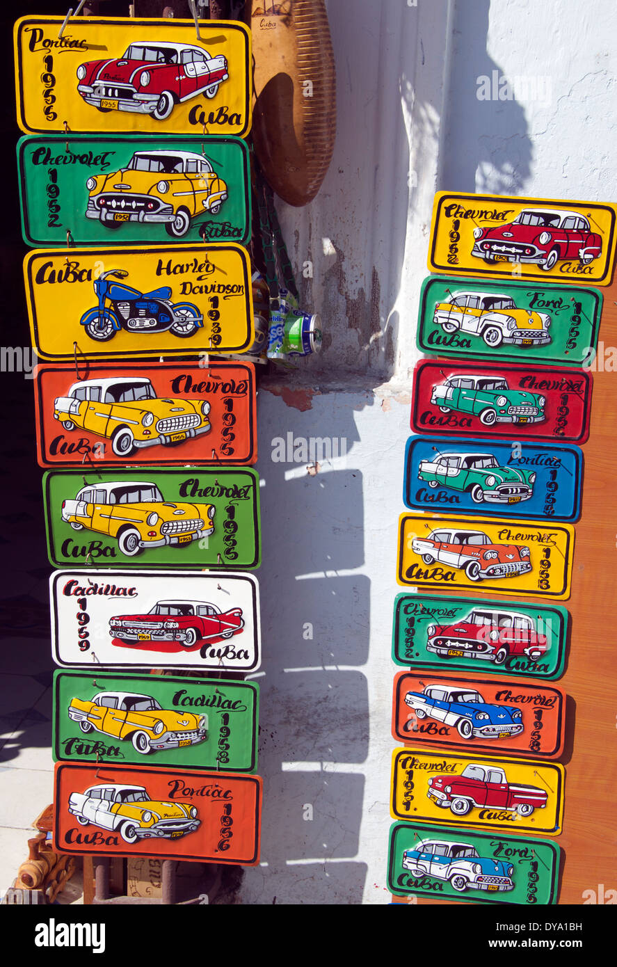 Shop displaying imitation car number plates Sancti Spiritus town, Sancti Spiritus Province Cuba - Stock Image