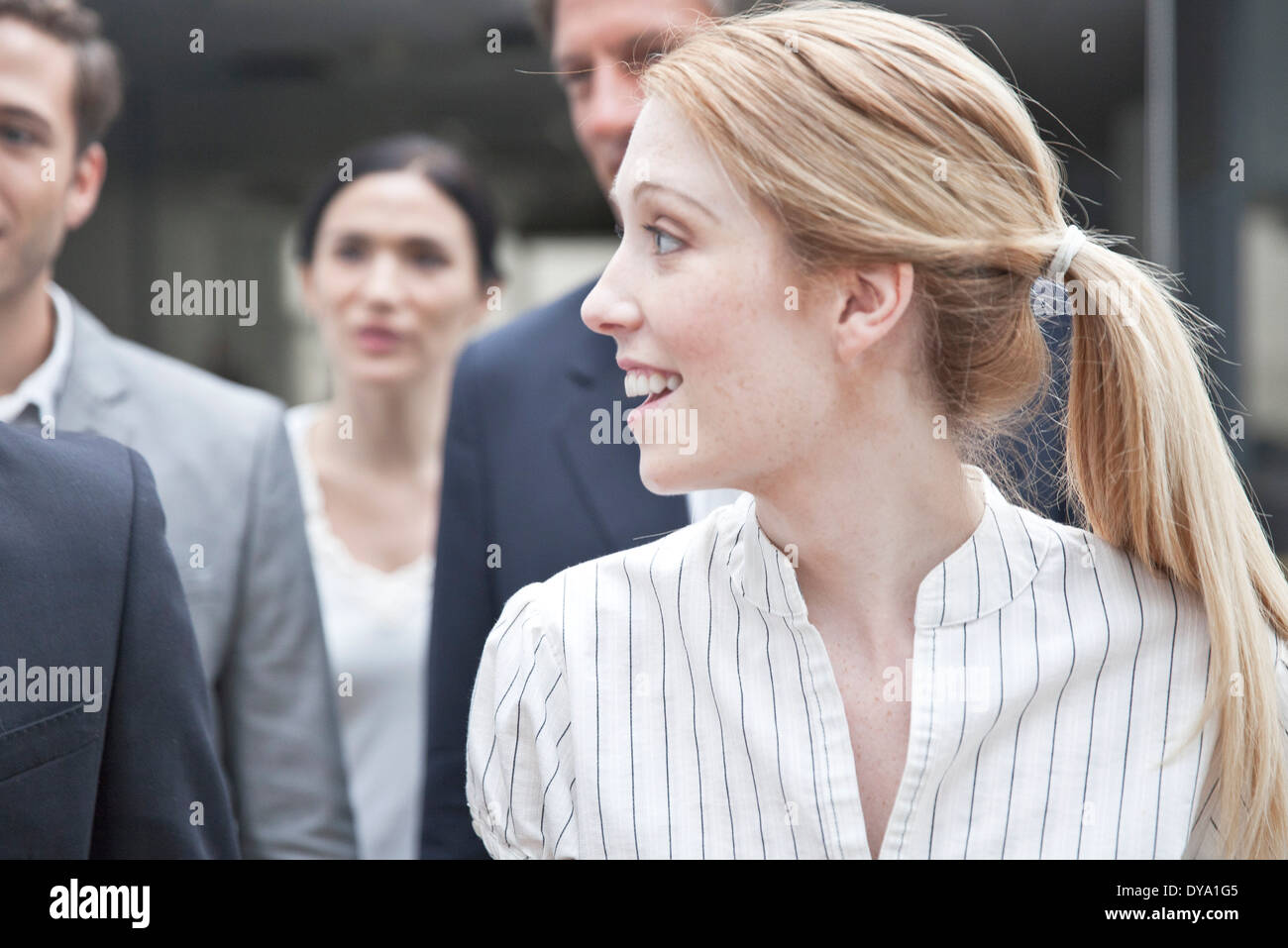 Businesswoman looking at associate - Stock Image