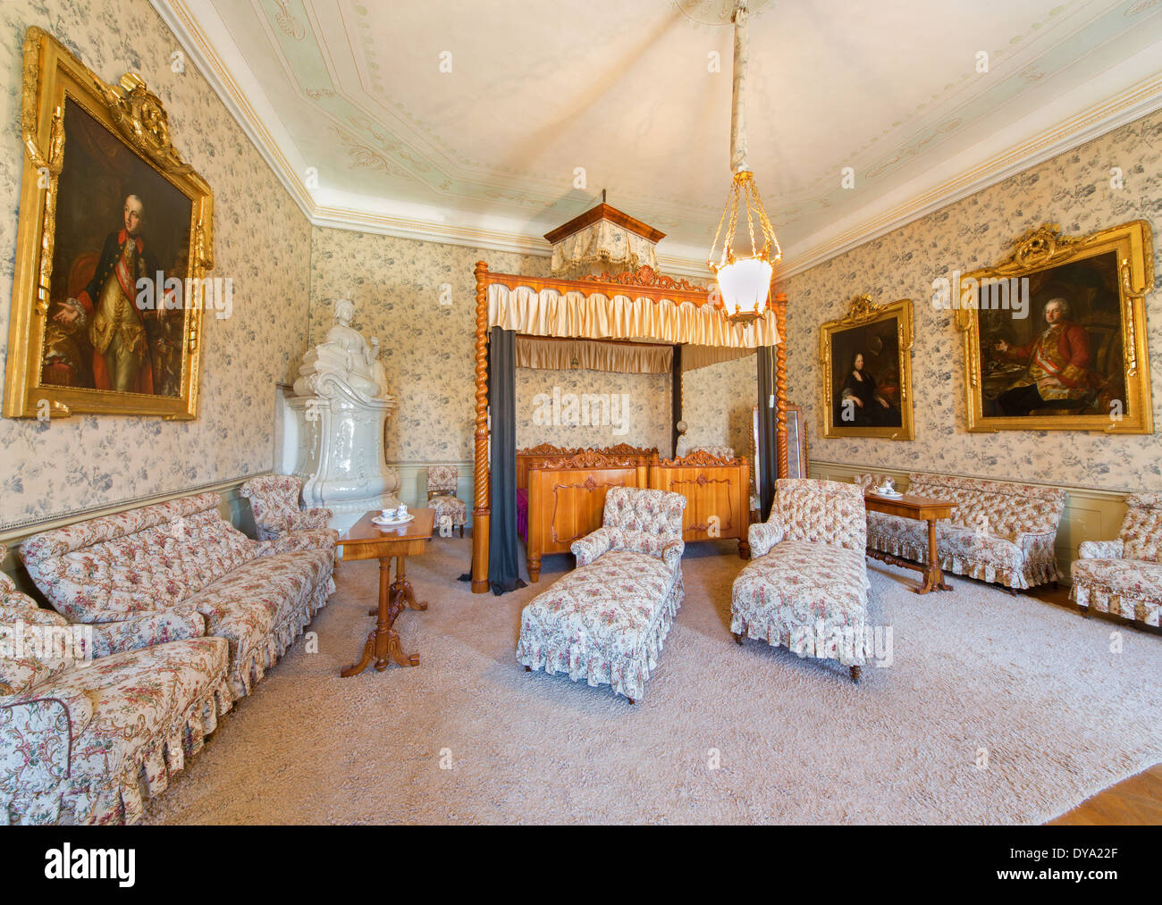 Bedroom carved in cherry wood from 19. cent in palace Saint Anton with the paint of Hapsburg emperor Joseph I on the left side. - Stock Image