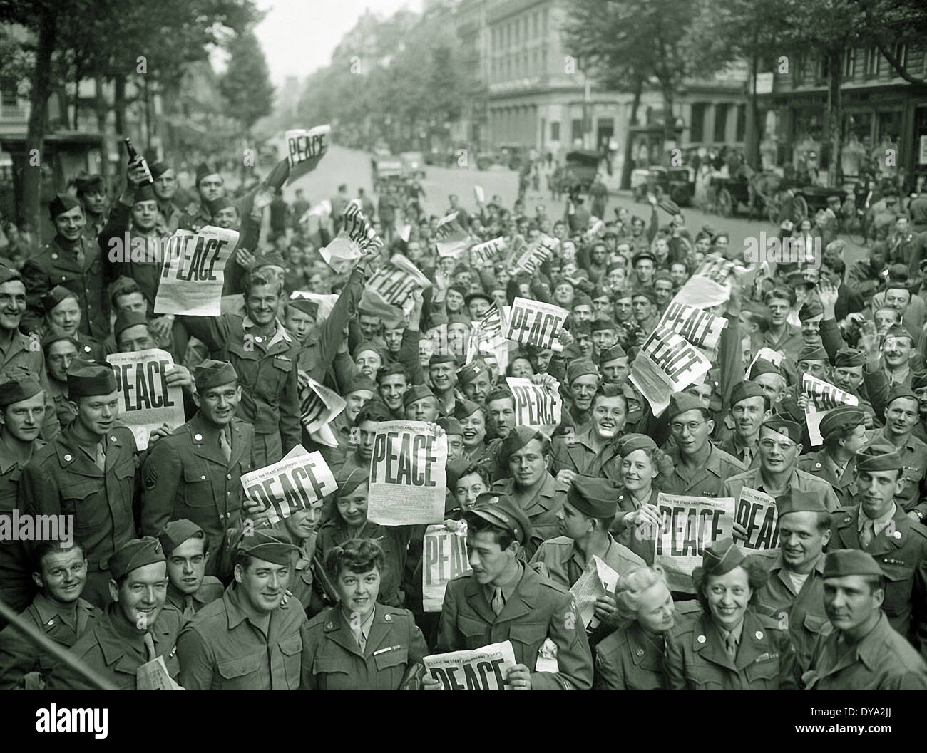 WW II historical war world war second world war France Europe American soldier women gather Paris unconditional capitulation, - Stock Image
