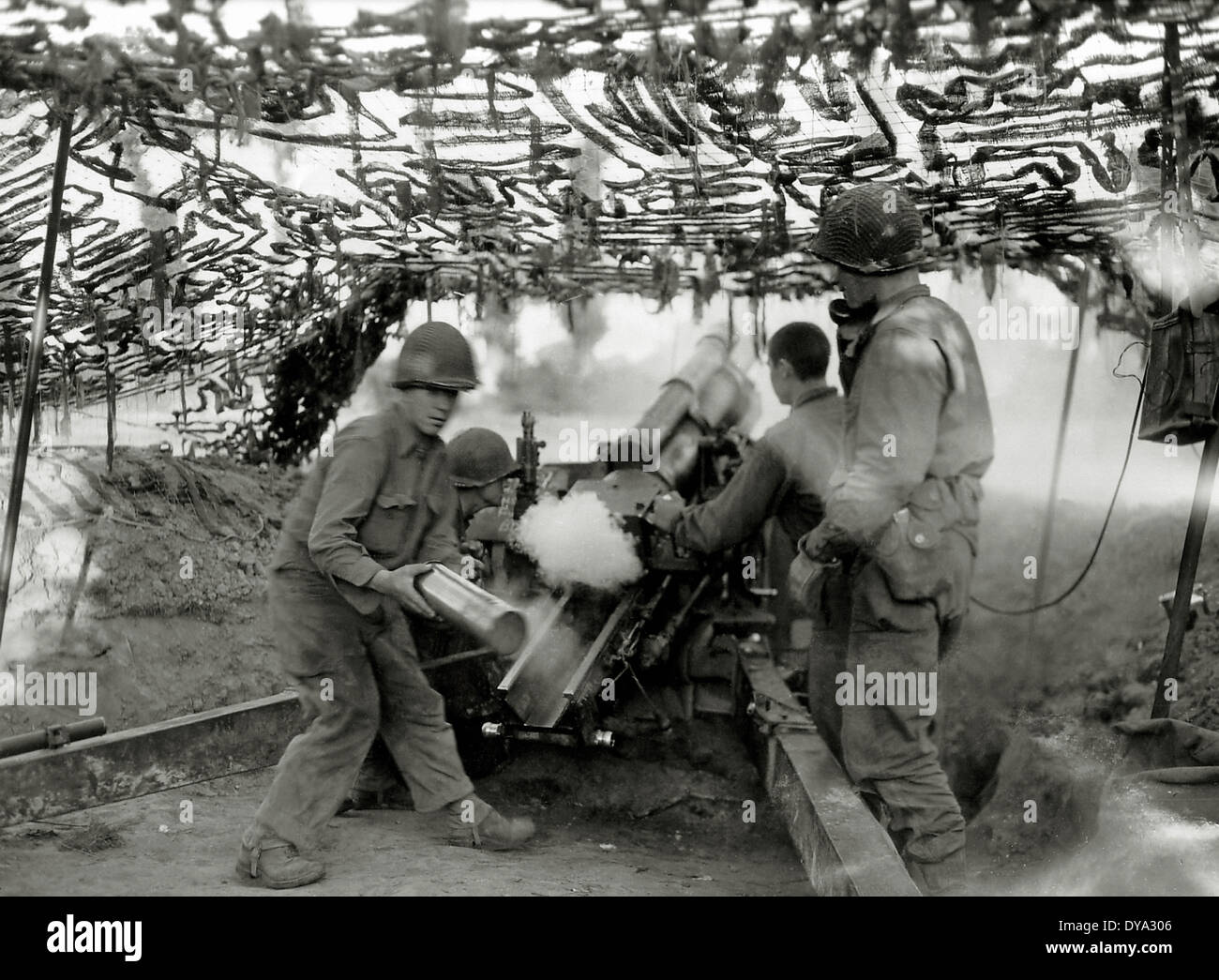 WW II historical war world war second world war operation Overlord Overlord invasion Howitzer HM2 camouflage netting fire July - Stock Image