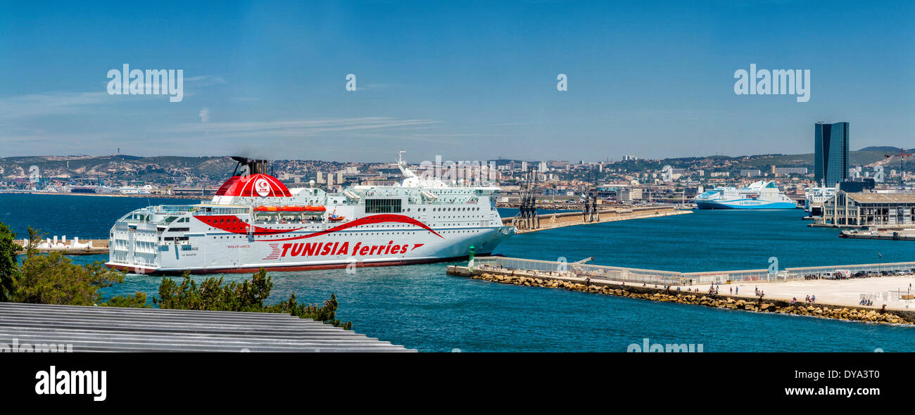 Ferry entering harbour Grand port maritime town village water summer sea ships boat Marseilles Bouches du Rhone Stock Photo