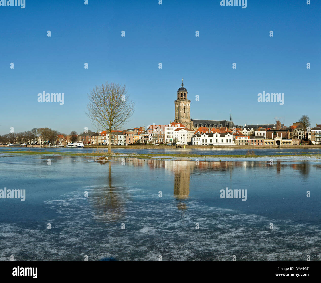 Netherlands Holland Europe Deventer Overijssel city village water winter snow ice reflections Lebuinus church river Stock Photo