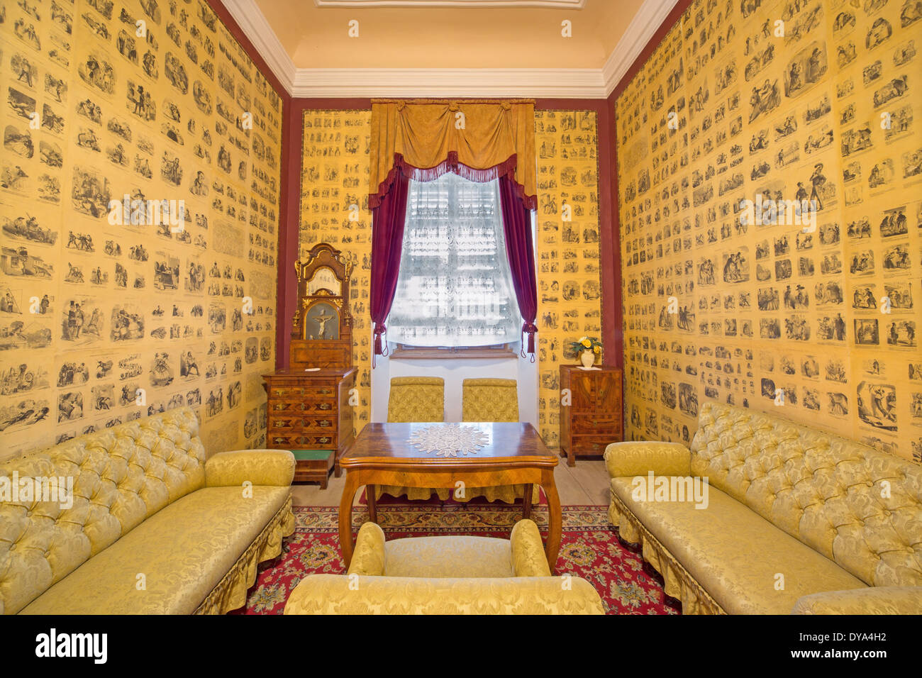 Saloon in palace Saint Anton with the drawings from French humoristic newspapers from 19. cent. as the wallpapers. - Stock Image