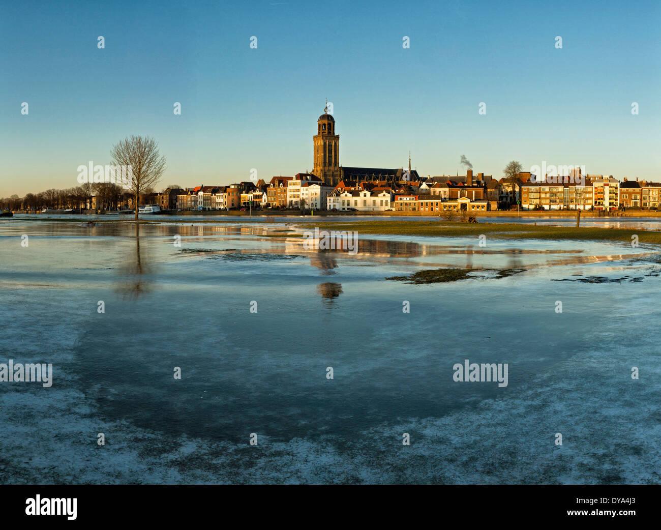 Netherlands Holland Europe Deventer Overijssel city village water winter snow ice reflections Lebuinus church frozen Stock Photo