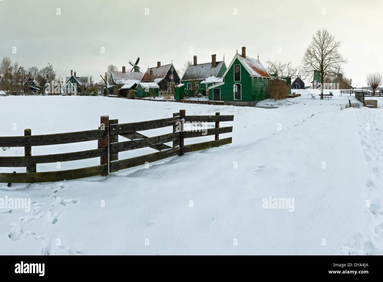 Netherlands Holland Europe Zaandam North Holland city village field meadow winter snow ice windmills Open-air museum Zaanse - Stock Image