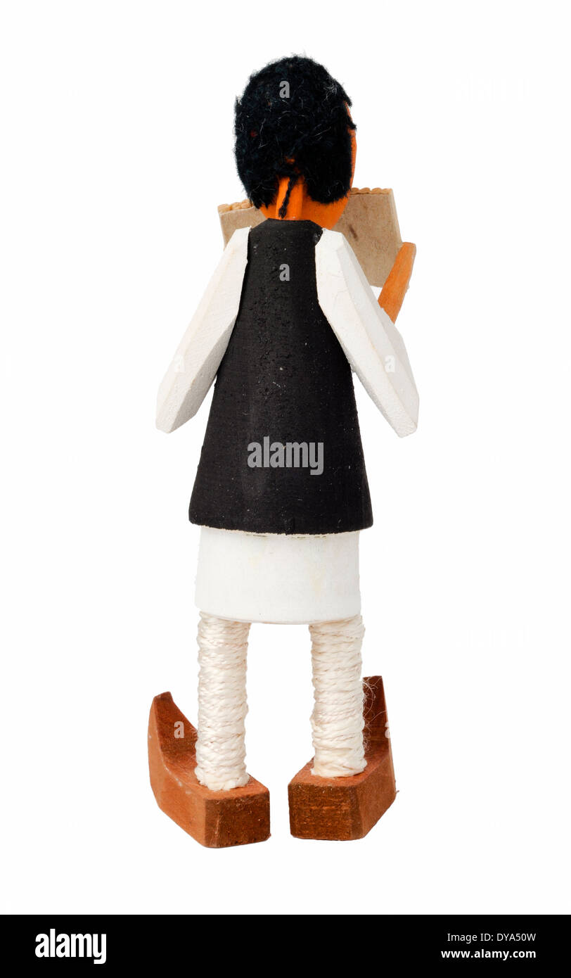 Wooden doll that sings at pan-pipe - Stock Image