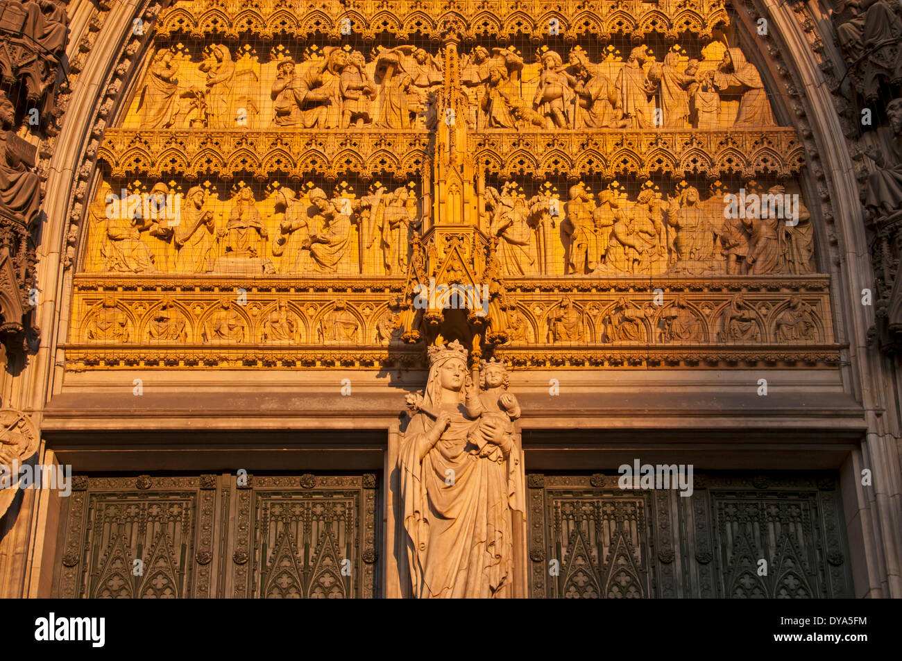 Germany cathedral dome redemption Europe entrance remedial history Jesus Cologne Mary statue Northrine-Westphalia west facade - Stock Image