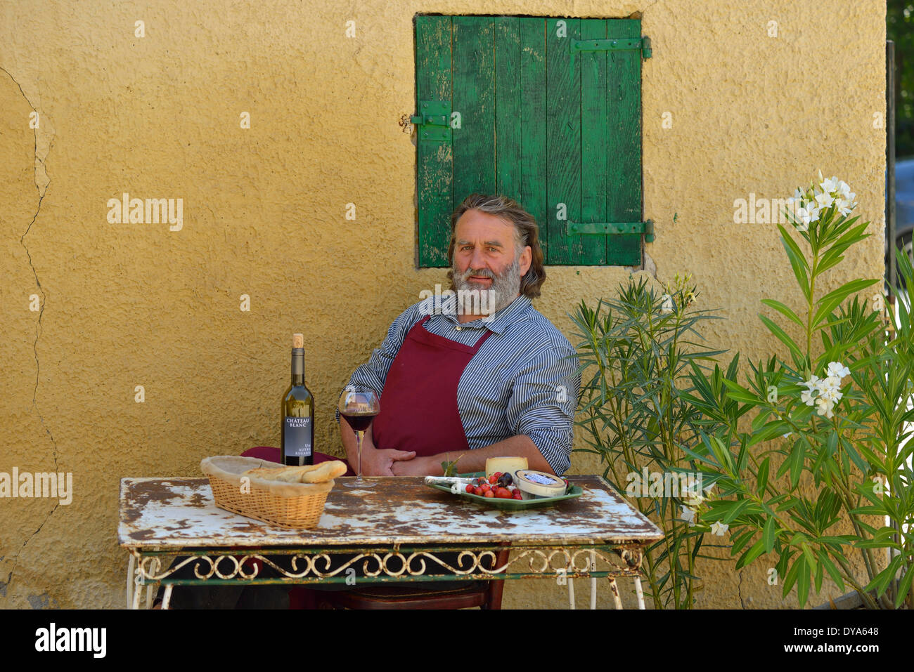 Europe, France, Provence, man, sit, french, table, wine, St. Saturnin les Apt, fifty - Stock Image