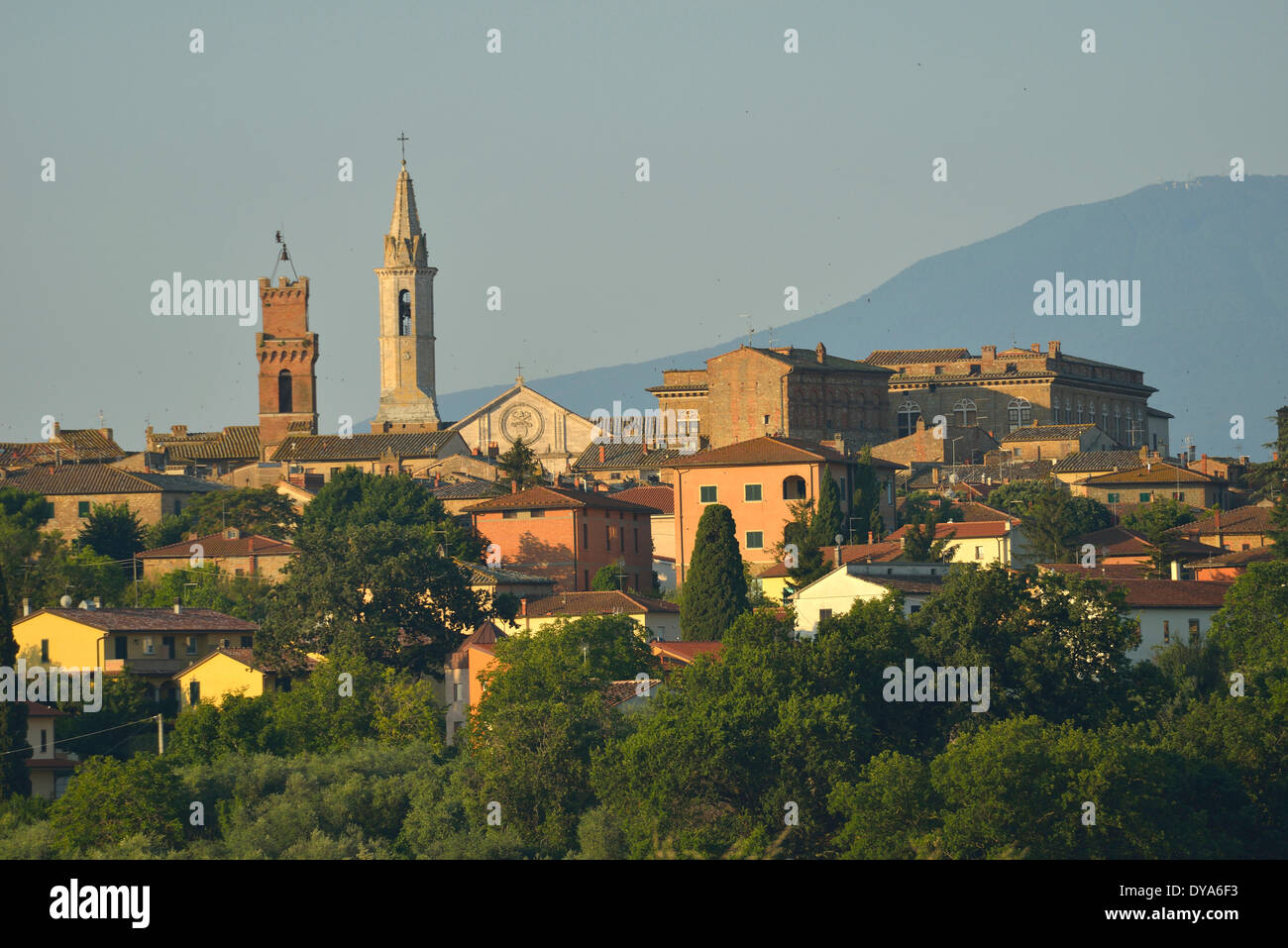 Europe mediterranean italian Italy Tuscany Siena Province Pienza village city hillside stucco minaret spire last light sunse - Stock Image