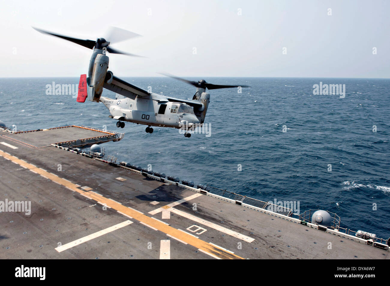 A US Marine MV-22 Osprey tiltrotor aircraft takes off from the flight deck of the amphibious assault ship USS Bonhomme Richard April 8, 2014 in the East China Sea. Stock Photo