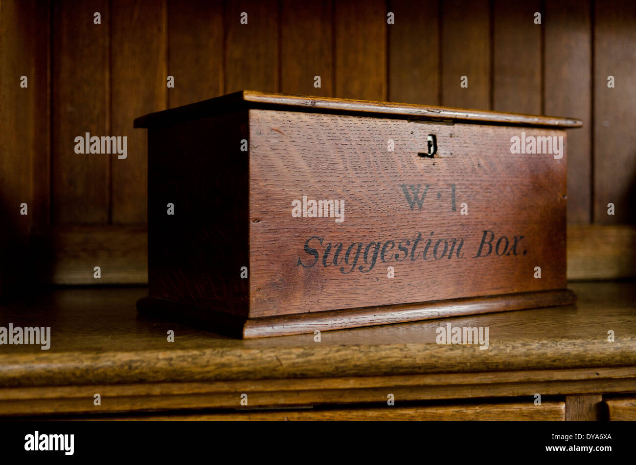 WI, Womens institute, suggestion box, wooden, on wooden kitchen cabinet - Stock Image