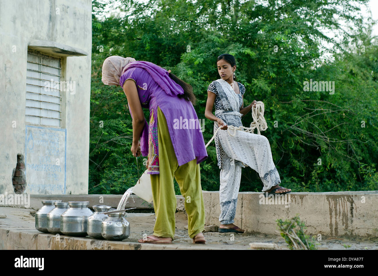 Women taking water from the well ,Kutch ,India - Stock Image