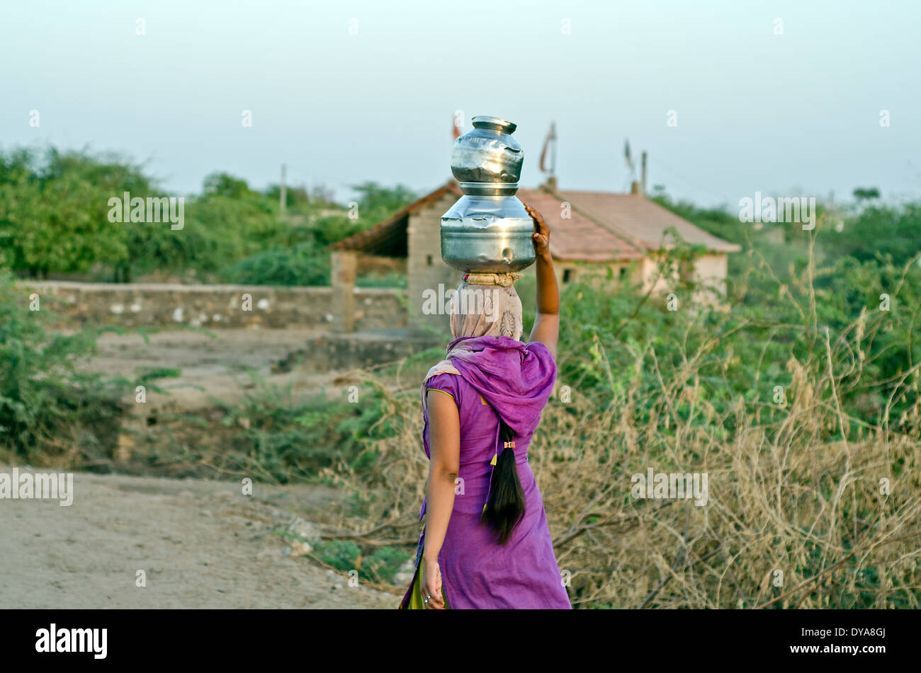 Woman carrying water from the well ,Kutch ,India - Stock Image