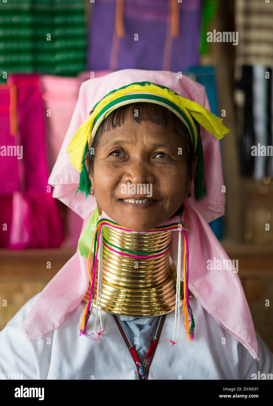 Giraffe woman Inle Myanmar Burma Asia attraction colourful faith lake neck long painful religion touristic tradition travel - Stock Image
