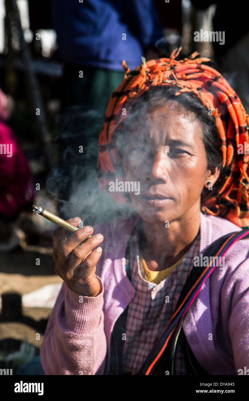 Inle, Iwama, Myanmar, Burma, Asia, cigar, colourful, face, mood, personality, serious, smoking, traditional, woman - Stock Image