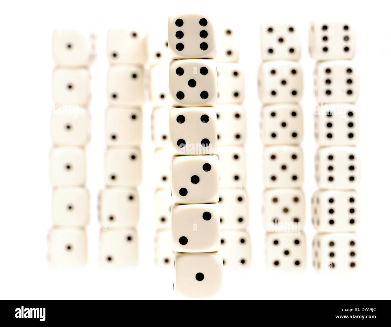 Ordered piles of dice - Stock Image