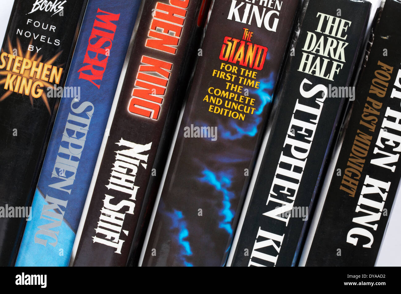 row of Stephen King books including Four Past Midnight, The Dark Half, the Stand, Night Shift, Misery and Four Novels by Stephen King - Stock Image