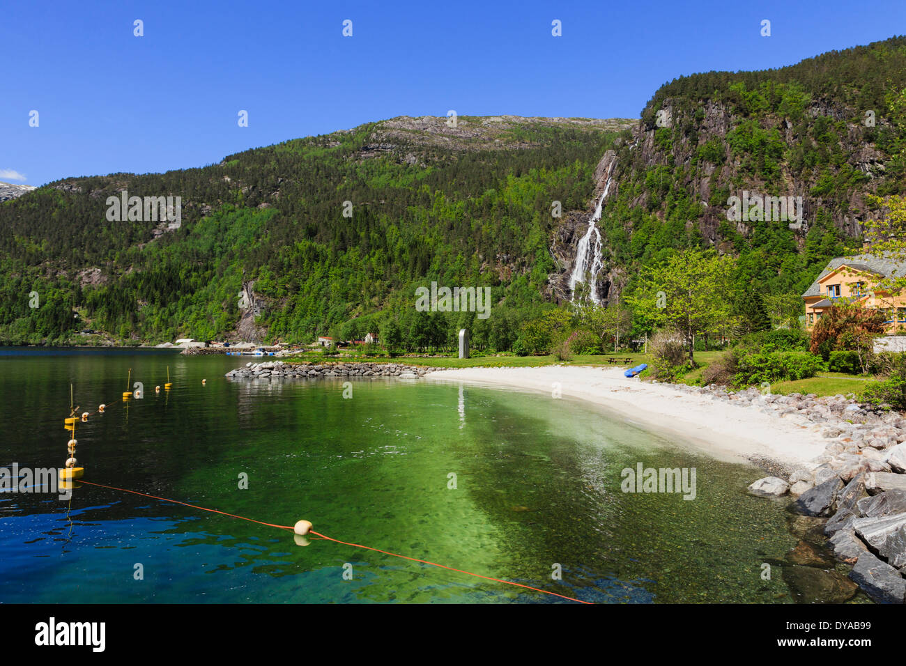Waterfall and sandy beach with safe swimming at end of Mofjorden fjord. Mo, Modalen, Hordaland, Norway, Scandinavia - Stock Image