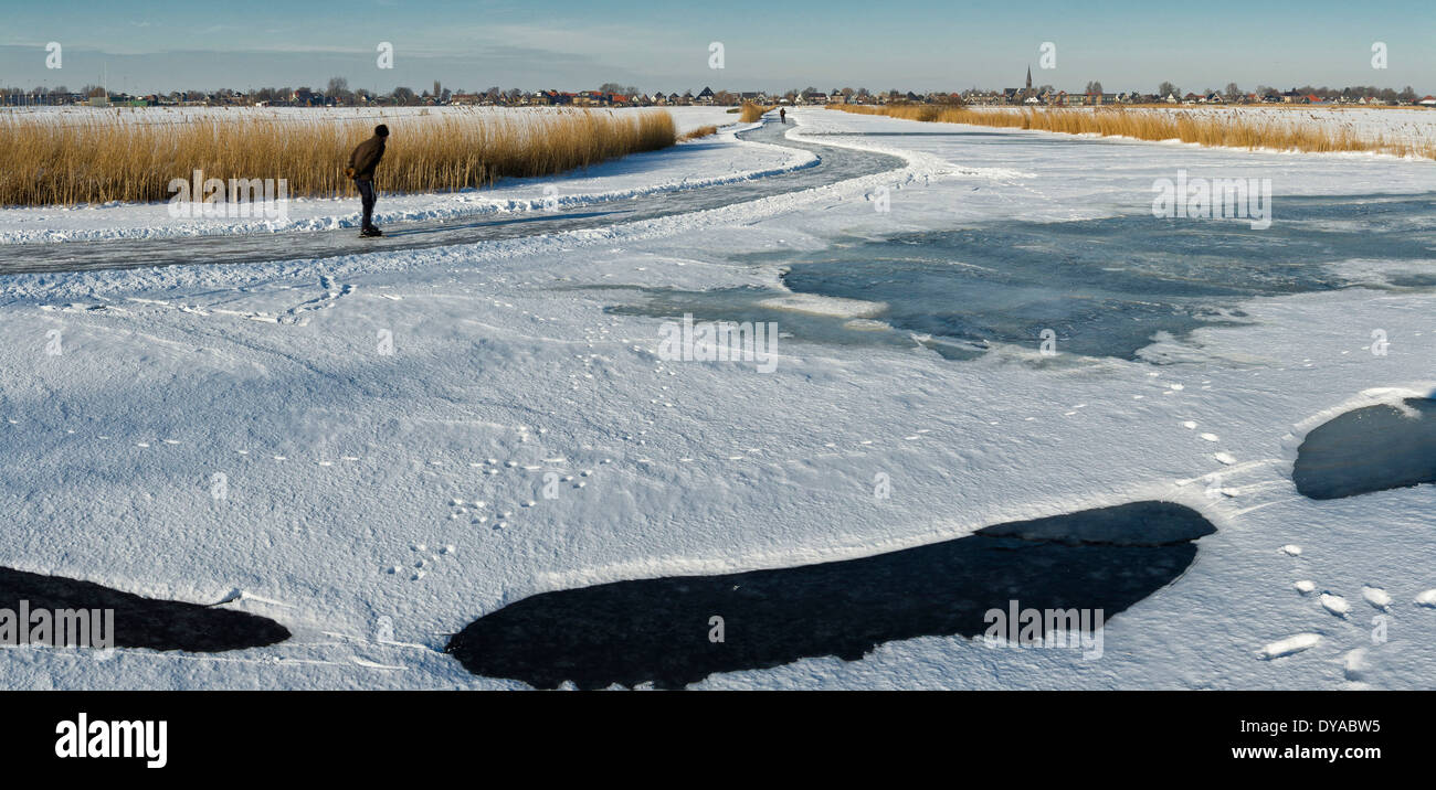 Netherlands, Holland, Europe, Wormer, North Holland, landscape, field, meadow, water, winter, snow, ice, people, Skating - Stock Image