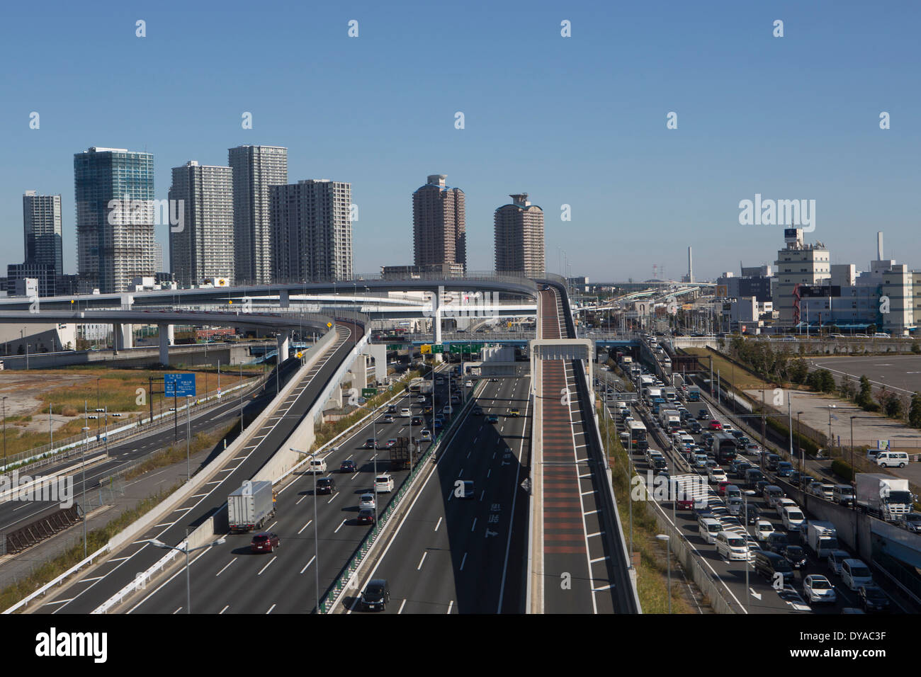 Japan Asia Tokyo City architecture bridge busy expressway highway jam new reclaimed land station traffic transport travel, - Stock Image