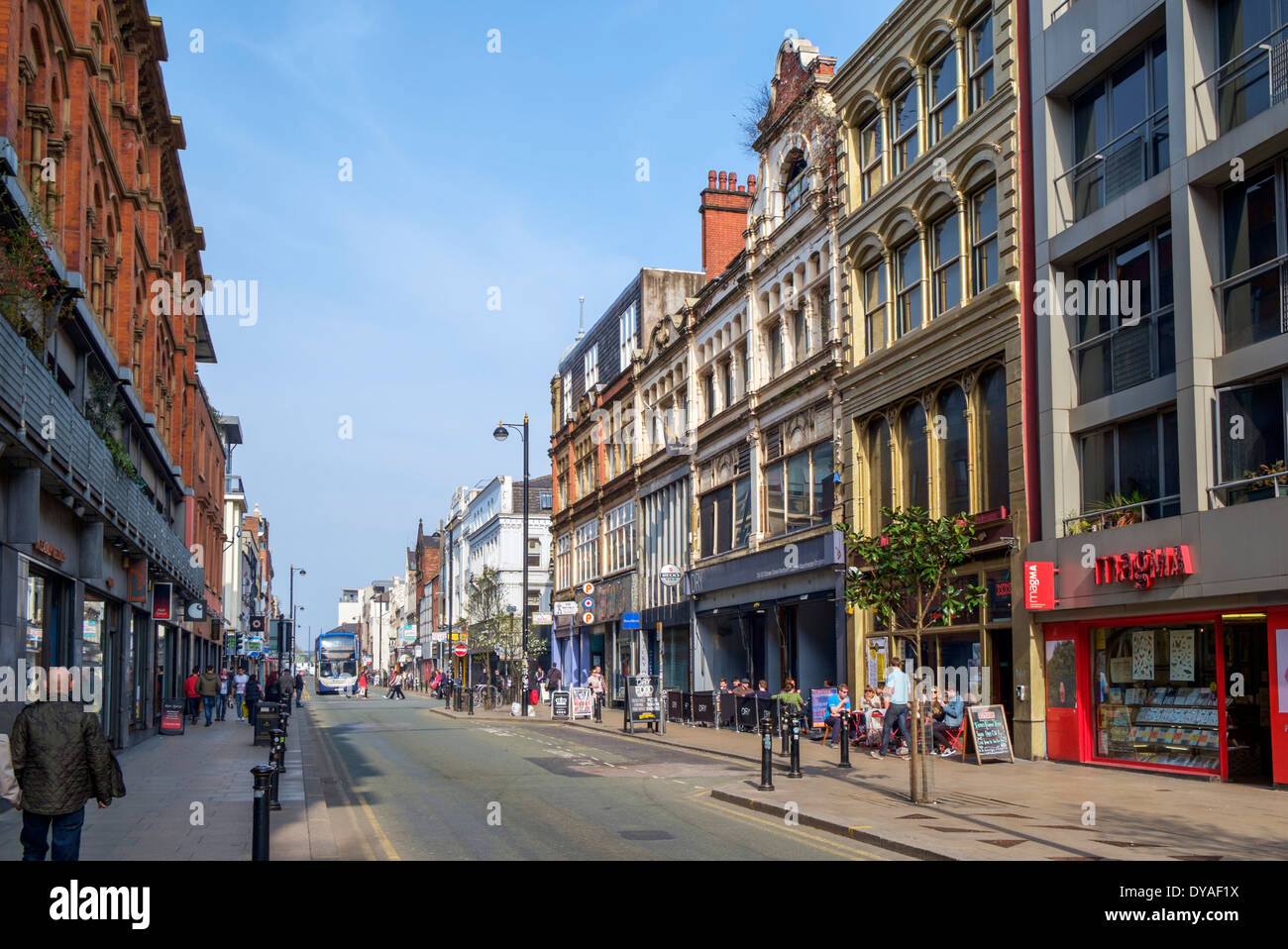 Shops, bars and cafes on Oldham Street in the Northern Quarter, Manchester, England, UK - Stock Image