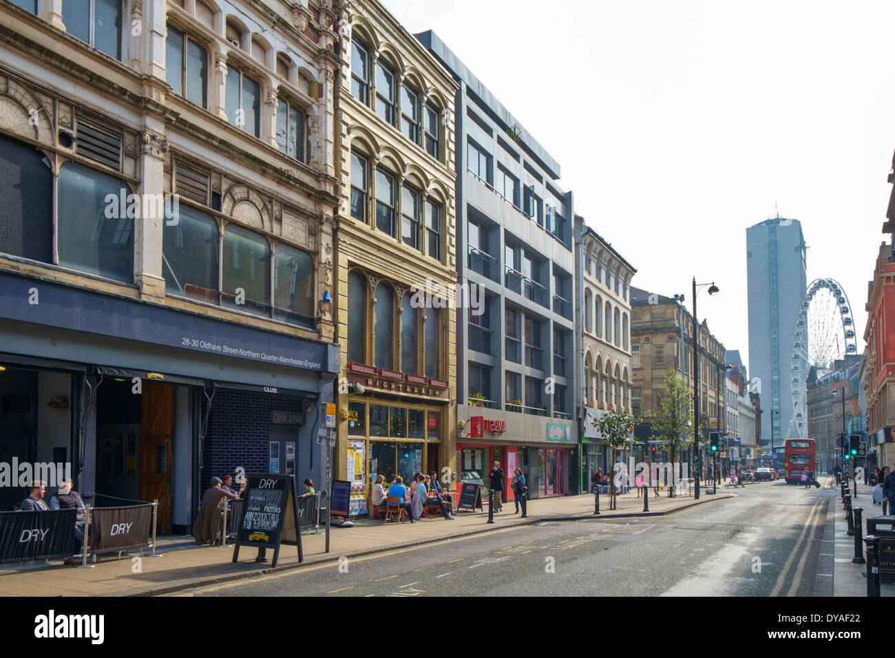 Oldham Street in the Northern Quarter, looking towards Piccadilly Gardens and the Manchester Wheel, Manchester, England, UK - Stock Image