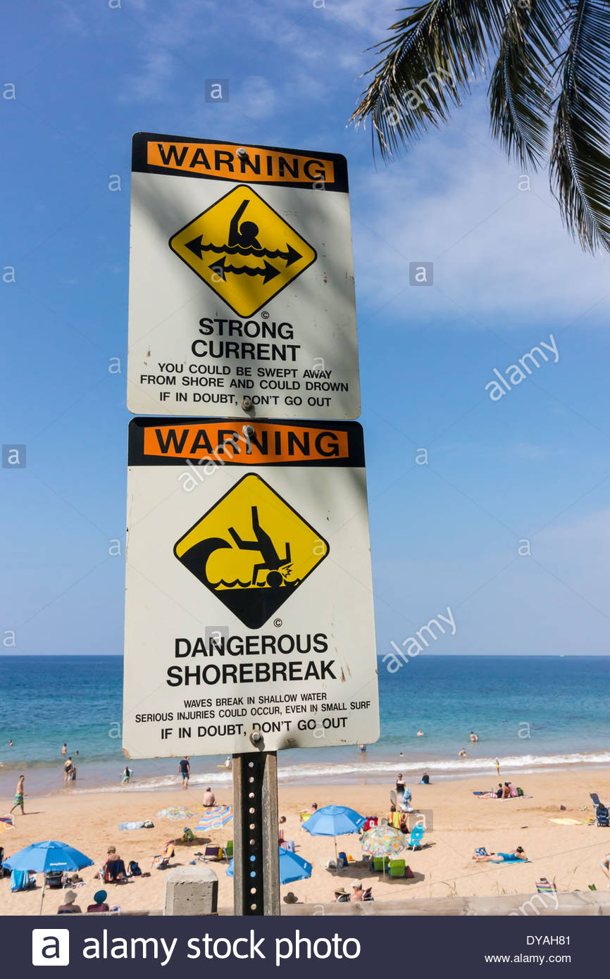 Sign warning of dangerous surf shorebreak at Kamaole Beach