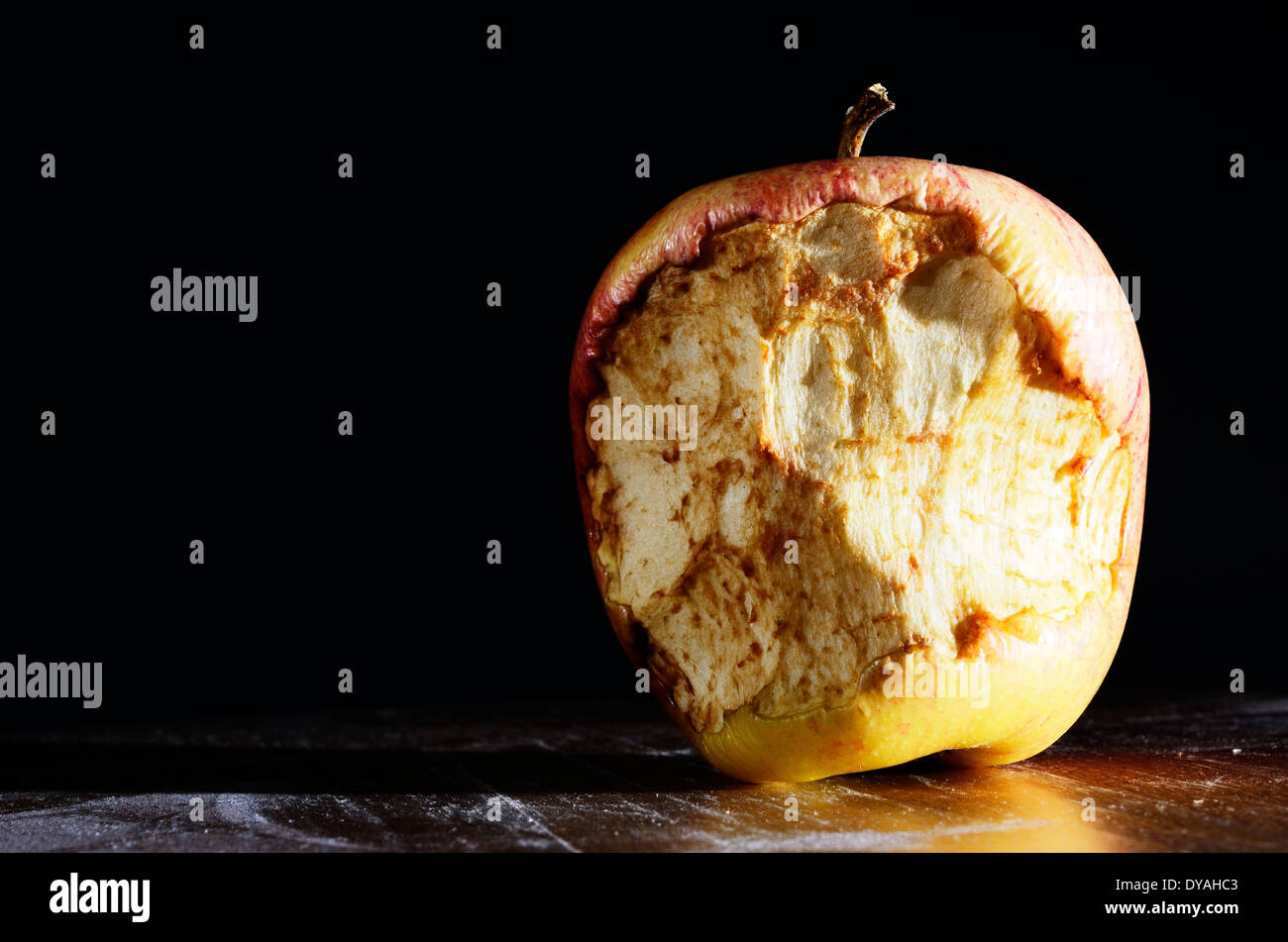 bitten apple on a dark background with room for text - Stock Image