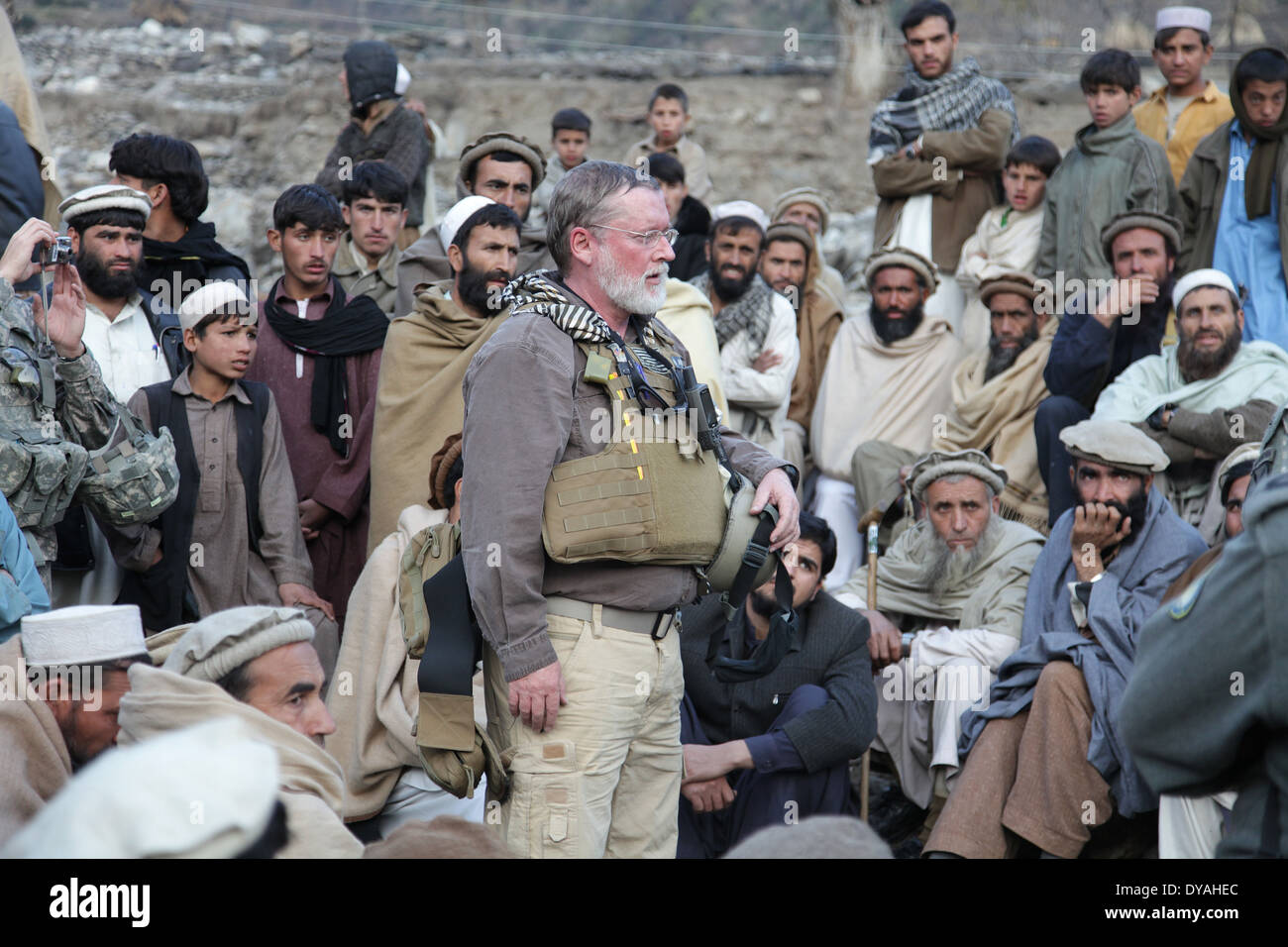 Ted Wittenberger, a US Agency for International Development representative with the Kunar Provincial Reconstruction Team, speaks to Afghan residents during a shura, or meeting December 7, 2009 in Lachey village, Shigal district, Kunar province, Afghanistan. - Stock Image
